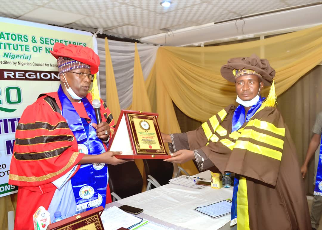 National President of CASPIN by the power invested on him by the Council inducts fellow awardees